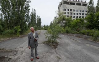 Ukrainian military pilot Mykola Volkozub looks around as he tries to find a place where he landed his helicopter in April 1986, in the abandoned city of Pripyat, near the Chernobyl nuclear power plant, Ukraine July 5, 2019. Picture taken July 5, 2019.  REUTERS/Valentyn Ogirenko