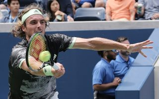 epa07797839 Stefanos Tsitsipas of Greece hits a return to Andrey Rublev of Russia during their match on the second day of the US Open Tennis Championships the USTA National Tennis Center in Flushing Meadows, New York, USA, 27 August 2019. The US Open runs from 26 August through 08 September.  EPA/PETER FOLEY
