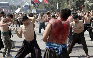 Afghan Shiites beat themselves with chains and blades to mark Ashura outside the Abul Fazel Shrine in Kabul, Afghanistan, Tuesday, Sept. 10, 2019. Ashoura falls on the 10th day of Muharram, the first month of the Islamic calendar, when Shiites mark the death of Hussein, the grandson of the Prophet Muhammad, at the Battle of Karbala in present-day Iraq in the 7th century. (AP Photo/Ebrahim Noroozi)