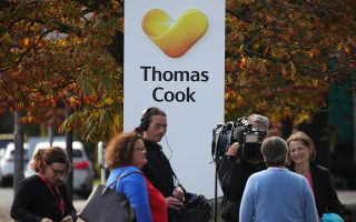 epa07868309 A representative of Thomas Cook Germany answers media questions in front of the headquarters of the German branch of Thomas Cook in Oberursel, Germany, 25 September 2019. Thomas Cook's German tour operator has filed for insolvency on 25 September.  EPA/ARMANDO BABANI