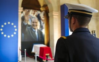 A military officer stands guard in front of the coffin of late French President Jacques Chirac, Sunday, Sept. 29, 2019 at the Invalides monument in Paris. Jacques Chirac will lie in state Sunday during a public ceremony at the Invalides monument, where France honors its heroes. A memorial service and private funeral are planned for Monday. (AP Photo/Kamil Zihnioglu)