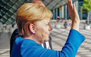 Η Αγκελα Μέρκελ μετά τη δεκαπεντάωρη διαπραγμάτευση. Ανακοινώνοντας το πακέτο, έκανε λόγο για την «τέχνη του εφικτού».