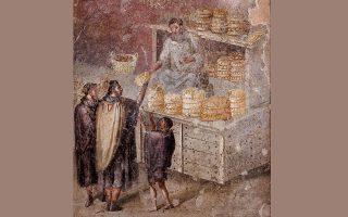 Τα καρβέλια ψήνονταν καθημερινά σε θολωτούς πέτρινους φούρνους. Τοιχογραφία από τον Οίκο του Φούρναρη, στην Πομπηία που απεικονίζει δημόσια διανομή άρτου.