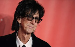 FILE - In this Feb. 6, 2015, file photo, Ric Ocasek of the Cars arrives at the MusiCares Person of the Year event at the Los Angeles Convention Center in Los Angeles. Ocasek, famed frontman for The Cars rock band, has been found dead in a New York City apartment. The New York City police department said officers responding to a 911 call found the 75-year-old Ocasek on Sunday, Sept. 15, 2019. (Photo by Richard Shotwell/Invision/AP, File)