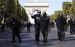 epaselect epa07858700 French riot Police secure a street near the Champs Elysees during the the 'Gilets Jaunes' (Yellow Vests) movement 'Act 45' demonstration (the 45th consecutive national protest on a Saturday) in Paris, France, 21 September 2019. The so-called 'gilets jaunes' (yellow vests) is a grassroots protest movement with supporters from a wide span of the political spectrum, that originally started with protest across the country in late 2018 against high fuel prices.  EPA/YOAN VALAT