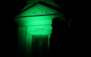 A tourist walks past Adams family mausoleum during the Moonlight Mausoleum tour at Woodlawn Cemetery in Bronx in New York City, New York, U.S., October 25, 2019. Picture taken October 25, 2019. REUTERS/Jeenah Moon