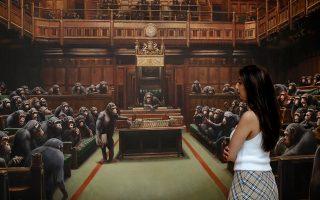 Χιμπατζήδες έχουν αντικαταστήσει τους βουλευτές στο κοινοβούλιο του μυστηριώδους καλλιτέχνη του δρόμου. ASSOCIATED PRESS/KIRSTY WIGGLESWORTH