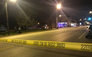 In this image from 41 KSHB Kansas City Action News police work the scene of a shooting outside a Kansas City, Kansas bar Sunday, Oct. 6, 2019. (41 KSHB Kansas City Action News via AP)