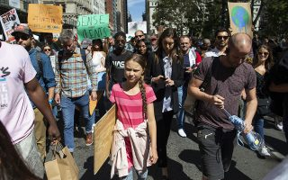 Swedish environmental activist Greta Thunberg, center, takes part during the Climate Strike, Friday, Sept. 20, 2019 in New York.Rallies calling for action on climate change are happening in cities around the world Friday ahead of a summit on the issue. (AP Photo/Eduardo Munoz Alvarez)