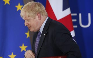 epaselect epa07928140 British Prime Minister Boris Johnson holds a news conference during a Brexit summit in Brussels, Belgium, 17 October 2019. According to reports, the EU and the British government have reached a deal for Brexit.  EPA/JULIEN WARNAND