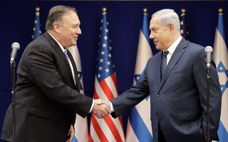 U.S. Secretary of State Mike Pompeo, left, shakes hands with Israeli Prime Minister Benjamin Netanyahu, during a meeting at the Prime Minister's residence in Jerusalem, Friday, Oct. 18, 2019. (AP Photo/Sebastian Scheiner, Pool)
