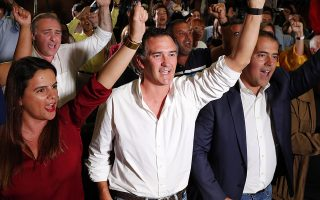 Supporters of Portuguese Prime Minister and Socialist Party leader Antonio Costa react following the announcement of firsts election results in Lisbon Sunday night, Oct. 6, 2019. An exit poll indicates the center-left Socialist Party has collected the most votes in Portugal's general election and is poised to continue in government for another four years. (AP Photo/Armando Franca)