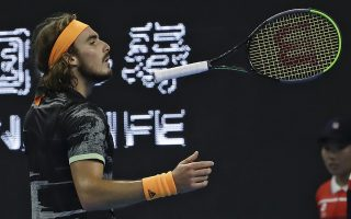 Stefanos Tsitsipas of Greece throws his racquet while competing against Dominic Thiem of Austria in the men's final at the China Open tennis tournament in Beijing, Sunday, Oct. 6, 2019. (AP Photo/Mark Schiefelbein)