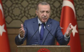 Turkish President Recep Tayyip Erdogan speaks during a meeting at his presidential palace, in Ankara, Turkey, Thursday, Oct. 24, 2019. Erdogan on Thursday renewed a threat to resume its military offensive if his country continued to be