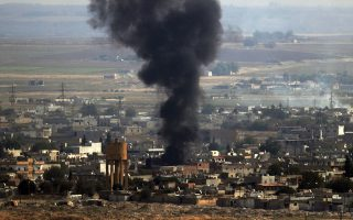 In this photo taken from the Turkish side of the border between Turkey and Syria, in Ceylanpinar, Sanliurfa province, southeastern Turkey, smoke billows from a fire on a target in Ras al-Ayn, Syria, caused by shelling by Turkish forces, Thursday, Oct. 17, 2019.  U.S. Vice President Mike Pence and State Secretary Mike Pompeo were scheduled to arrive in Ankara and press Turkey's President Recep Tayyip Erdogan to accept a ceasefire in northeast Syria. (AP Photo/Lefteris Pitarakis)