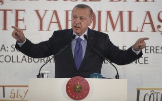 Turkish President Recep Tayyip Erdogan addresses an African Muslim Religious Leaders Summit, in Istanbul, Saturday, Oct. 19, 2019. Turkey's Interior Minister Suleyman Soylu says 41 suspected Islamic State members were re-captured after fleeing a detention camp earlier this week in Syria, and Erdogan has accused Syrian Kurdish forces of releasing some 750 IS members and families, amid Turkey's offensive. (Presidential Press Service via AP, Pool )