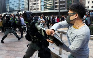 A protester scuffles with a riot police officer during an anti-government demonstration in Central District in Hong Kong, China, November 13, 2019. REUTERS/Athit Perawongmetha