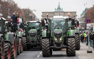 epa08026077 A row of tractors blocks the street as thousands of German farmers demonstrate along the 17 Juni street and Brandenburg Gate in Berlin, Germany, 26 November 2019. Some 5,000 farmers and their tractors gathered in the German capital to protest a series of measures taken against the agricultural community, from climate laws to the recent agrarian package, which was presented by Federal Agriculture Minister Julia Kloeckner (CDU) and Environment Minister Svenja Schulze (SPD) in September.  EPA/OMER MESSINGER