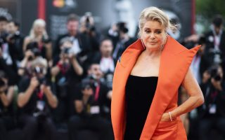 FILE - In this Aug. 28, 2019 file photo, French actress Catherine Deneuve poses for photographers upon arrival at the premiere of the film 'The Truth' and the opening gala at the 76th edition of the Venice Film Festival, Venice, Italy. Denueve's family said in a statement released Wednesday Nov. 6, 2019, that the 76-year-old actress suffered a