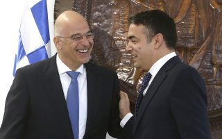 Greek Foreign Minister Nikos Dendias, left, is welcomed by his North Macedonia's counterpart Nikola Dimitrov, right, at the ministry of foreign affairs in Skopje, North Macedonia, on Tuesday, Nov. 26, 2019. Dendias arrived Tuesday in Skopje to discuss the bilateral relations and to express Greek support to the Balkan country's bid to open the membership talks with European Union. (AP Photo/Boris Grdanoski)