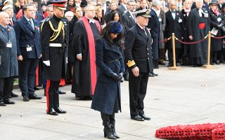 epa07978477 Britain's Meghan (C), Duchess of Sussex and Prince Harry (L), Duke of Sussex attend the 91st Field of Remembrance at Westminster Abbey in London, Britain, 07 November 2019. The Field of Remembrance has been organised by The Poppy Factory and held in the grounds of Westminster Abbey since November 1928. 70,000 crosses are produced each year which are planted on more than 360 plots for regimental and other associations.  EPA/NEIL HALL