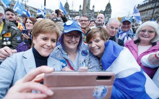 epa07967615 Scottish First Minister and SNP leader Nicola Sturgeon (L) poses for a selfie picture picture with supporters at an independence rally in George Square, Glasgow, Scotland, Britain, 02 November 2019. Thousands of supporters of Scottish independence have gathered in Glasgow to demand second independence referendum.  EPA/ROBERT PERRY