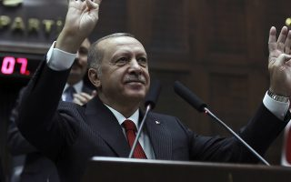 Turkish President Recep Tayyip Erdogan addresses his ruling party legislators at the Parliament, in Ankara, Tuesday, Nov. 5, 2019. Erdogan called on Russia and the United States on Tuesday to keep to their promises to ensure that Syrian Kurdish fighters pull out of Syrian borders areas with Turkey.(AP Photo/Burhan Ozbilici)