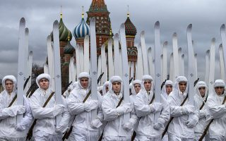 Russian soldiers dressed in Red Army World War II winter uniforms take a part in a reconstruction of a World War II-era parade in Moscow's Red Square with St. Basil Cathedral in the background, Russia, Thursday, Nov. 7, 2019. The Nov. 7, 1941 parade saw Red Army soldiers move directly to the front line in the Battle of Moscow, becoming a symbol of Soviet valor and tenacity in the face of overwhelming odds. (AP Photo/Alexander Zemlianichenko)