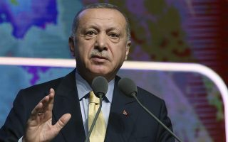 Turkish President Recep Tayyip Erdogan speaks during a meeting in Ankara, Turkey, Wednesday, Nov. 6, 2019. Erdogan says Turkey has captured a wife of the slain leader of the Islamic State group, Abu Bakr al-Baghdadi. Erdogan made the announcement while delivering a speech in Ankara on Wednesday but gave no other details. (Presidential Press Service via AP, Pool)