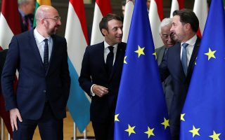 European Council President Charles Michel, French President Emmanuel Macron, Portugal's Prime Minister Antonio Costa and Luxembourg's Prime Minister Xavier Bettel talk during a family photo opportunity at the European Union leaders summit in Brussels, Belgium December 12, 2019. REUTERS/Yves Herman