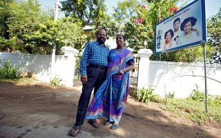 Karibeeran Paramesvaran and his wife Choodamani, who lost three children in the 2004 tsunami, pose outside their house that they have turned into a care home for orphaned children in Nagapattinam district in the southern state of Tamil Nadu, India, December 4, 2019. Picture taken December 4, 2019. REUTERS/P. Ravikumar