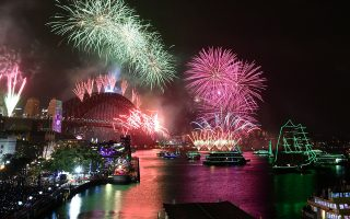 Fireworks explode to welcome in the New Year over the Sydney Harbour Bridge and the Sydney Opera House, as seen from Cahill Expressway during New Year's Eve celebrations in Sydney, Australia, January 1, 2020. AAP Image for City of Sydney/Dean Lewins/via REUTERS  ATTENTION EDITORS - THIS IMAGE WAS PROVIDED BY A THIRD PARTY. NO RESALES. NO ARCHIVE. AUSTRALIA OUT. NEW ZEALAND OUT. NO COMMERCIAL OR EDITORIAL SALES IN NEW ZEALAND. NO COMMERCIAL OR EDITORIAL SALES IN AUSTRALIA.