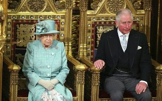 Britain's Queen Elizabeth II and the Prince of Wales sit in the chamber ahead of the State Opening of Parliament by the Queen, in the House of Lords at the Palace of Westminster in London, Thursday Dec. 19, 2019. Queen Elizabeth II will formally open a new session of Britain's Parliament on Thursday, with a speech giving the first concrete details of what Prime Minister Boris Johnson plans to do with his commanding House of Commons majority. (Aaron Chown, Pool via AP)