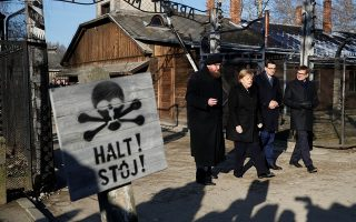 German Chancellor Angela Merkel, Poland's Prime Minister Mateusz Morawiecki and museum director Piotr Cywinski walk past the