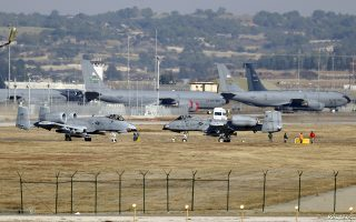 U.S. Air Force A-10 Thunderbolt II fighter jets (foreground) are pictured at Incirlik airbase in the southern city of Adana, Turkey, in this December 11, 2015 file photo. REUTERS/Umit Bektas/Files - GF10000364314