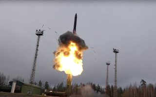 In this photo taken from undated footage distributed by Russian Defense Ministry Press Service, an intercontinental ballistic missile lifts off from a truck-mounted launcher somewhere in Russia. The Russian military said the Avangard hypersonic weapon entered combat duty on Friday. The Kremlin has made modernization of Russia's strategic nuclear forces one of its top priorities. (Russian Defense Ministry Press Service via AP)