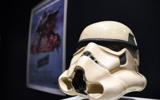 The prototype of an Imperial Stormtrooper helmet of 1976 is displayed at Sotheby's, as part of the Star Wars auction in London, Friday, Dec. 6, 2019. Sotheby's will now host its second sale dedicated to 'Star Wars' collectibles, titled 'Star Wars Online'. (AP Photo/Alberto Pezzali)