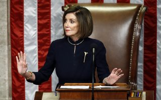 House Speaker Nancy Pelosi of Calif., gestures for Democrats to stop taking during a vote on the articles of impeachment against President Donald Trump, Wednesday, Dec. 18, 2019, on Capitol Hill in Washington. (AP Photo/Patrick Semansky)