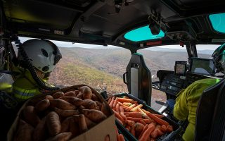NSW's National Parks and Wildlife Service staff fly with carrots and sweet potatoes before air-dropping them for animals in bushfire-stricken areas around Wollemi National Park, New South Wales, Australia January 10, 2020. Picture taken January 10, 2020. NSW DPIE Environment, Energy and Science/Handout via REUTERSTHIS IMAGE HAS BEEN SUPPLIED BY A THIRD PARTY. MANDATORY CREDIT. NO RESALES. NO ARCHIVES
