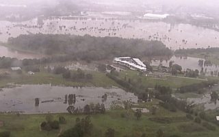 This image from a video, shows flooded fields on Gold Coast, Australia Saturday, Jan. 18, 2020. Heavy rain lashed parts of Australia's New South Wales and Queensland states on Saturday causing flashfloods, while wildfires continue to burn in other parts of the country. (Australian Broadcasting Corporation, Channel 7, Channel 9 via AP)