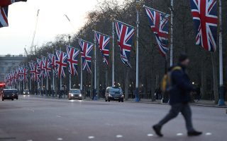 FILE PHOTO: British flags are seen in The Mall street in London, Britain January 29, 2020. REUTERS/Antonio Bronic/File Photo