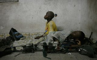A boy afflicted by polio prays before going to sleep on the floor inside the International Polio Victim Response Committee (IPVRC) compound in Democratic Republic of Congo's capital Kinshasa, November 22, 2006. Results from historic elections in Congo were announced last week as the country tries to end years of conflict that has left the country destitute with a non-functional health care system. REUTERS/Finbarr O'Reilly (DEMOCRATIC REPUBLIC OF CONGO)