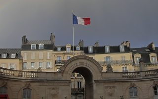 A rainbow fills the sky over the Elysee Palace in Paris, Friday, Jan. 17, 2020. (AP Photo/Michel Euler)
