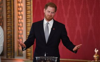 Britain's Prince Harry attends at the draw for the Rugby League World Cup, where children from a local school will play rugby league in the Buckingham Palace gardens, in London, Britain January 16, 2020. Jeremy Selwyn/Pool via REUTERS