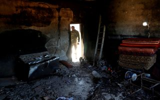 FILE PHOTO: A fighter loyal to Libya's U.N.-backed government (GNA) looks at a room burned during clashes with troops loyal to Khalifa Haftar in Wadi Rabiya neighbourhood at outskirts of Tripoli, Libya May 28, 2019. REUTERS/Goran Tomasevic/File Photo