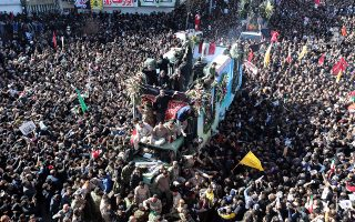 epa08109732 Iranians carrying the coffin of late Iranian Revolutionary Guards Corps (IRGC) Lieutenant general and commander of the Quds Force Qasem Soleimani and his allies in his home town Kerman, Iran, 07 January 2020. Media reported that some people have been died as stuck in the crowd during the funeral.  EPA/STR