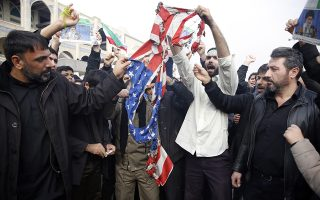 epa08099835 Iranians burn a US flag as thousands of people take to the streets to mourn the death of Iranian Revolutionary Guards Corps (IRGC) Lieutenant general and commander of the Quds Force Qasem Soleimani during an anti-US demonstration to condemn the killing of Soleimani, after Friday prayers in Tehran, Iran, 03 January 2020. The Pentagon announced that Iran's Quds Force leader Qasem Soleimani and Iraqi militia commander Abu Mahdi al-Muhandis were killed on 03 January 2020 following a US airstrike at Baghdad's international airport. The attack comes amid escalating tensions between Tehran and Washington.  EPA/ABEDIN TAHERKENAREH
