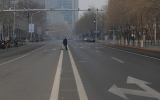 epa08169663 A man wears a mask while walking through the empty streets of Beijing, China, 27 January 2020. China warned that the coronavirus outbreak is accelerating further, deepening fears about an epidemic that has affected more than 2,700 people worldwide and killed at least 80 people in the country.  EPA/WU HONG