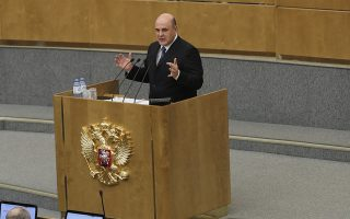 epa08133110 Russian Prime Minister nominee Mikhail Mishustin speaks during a plenary session at the State Duma in Moscow, Russia, 16 January 2020. Russian President Vladimir Putin submitted the candidacy of Russian Federal Taxation Service Head Mikhail Mishustin for the post of Russian Prime Minister after the Russian government resigned on 15 January 2020 following Putin's address to the federal Assembly. The Russian State Duma approved the president's nomination on 16 January 2020.  EPA/YURI KOCHETKOV