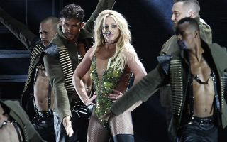 "FILE - In this June 13, 2017, file photo, U.S. singer Britney Spears performs during her concert in Taipei, Taiwan. Spears is taking her act on the road this summer with her ""Piece of Me"" world tour, traveling across North America and Europe. The first show is July 12 in Washington. (AP Photo/Chiang Ying-ying, File) ORG XMIT: NYET312"